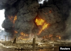 FILE - Nigeria's amnesty program for ex-militants was begun in 2009 to stop the sabotage of oil facilities, like this attack on a pipeline in Andoni in December 2005.