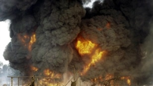 FILE - Nigeria's amnesty program for ex-militants was begun in 2009 to stop the sabotage of oil facilities, like this attack on a pipeline in Andoni in December 2005. Recent attacks have raised fears of renewed militancy in the area.