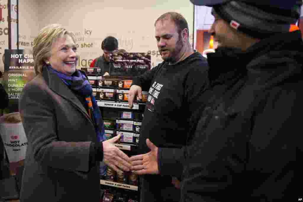 Democratic presidential candidate Hillary Clinton meets with customers as she stops at Dunkin' Donuts during the first-in-the-nation presidential primary, Feb. 9, 2016, in Nashua, N.H.