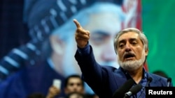 FILE - Afghan presidential candidate Abdullah Abdullah meets with supporters in Kabul, July 8, 2014.