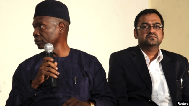Francis Ogboro (L) and Suhail Farooqui, representatives of Dana Air, attend a news conference at Lagos State University Teaching Hospital, June 6, 2012.