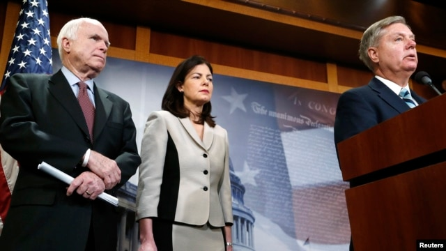 FILE - From left, Republican U.S. Senators John McCain of Arizona, Kelly Ayotte of New Hampshire and Lindsey Graham of South Carolina talk to reporters on Capitol Hill about legislation aimed at restricting prisoner transfers from Guantanamo Bay, Jan. 13, 2015.
