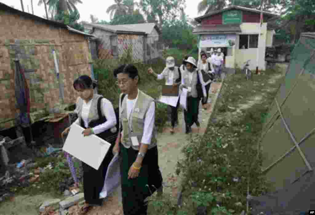 Myanmar census enumerators leave a government office in Dala township Sunday, March 30, 2014, in Yangon, Myanmar. Enumerators fanned out across Myanmar on Sunday for a census that has been widely criticized for stoking religious and ethnic tensions, afte