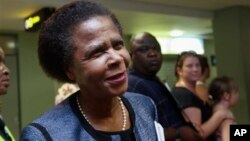 Former South African anti-apartheid activist Mamphela Ramphele speaks to reporters at the East London airport in Eastern Cape, South Africa, after arriving to attend the late former South African President Nelson Mandela's funeral, Saturday, December 14.