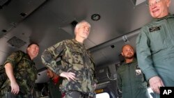 Chairman of NATO Military Committee General Petr Pavel, center, boards an Italian helicopter during the opening ceremony of NATO Trident Juncture exercise 2015, in Trapani, Italy, Oct. 19, 2015.