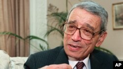 FILE - Former United Nations Secretary-General Boutros Boutros-Ghali gestures during an interview with the Associated Press in New York, May 21, 1997.
