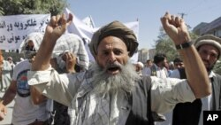 """An Afghan man shouts anti-Pakistan slogans during a demonstration in Kabul. Around 150 Afghans took to the streets in the capital Kabul on Saturday, chanting """"Death to Pakistan"""" in protest against the weeks of cross-border shelling of two eastern province"""