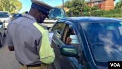 Police enforcing COVID-19 regulations. (VOA)