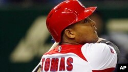 FILE - Cuban Yasmany Tomas is seen hitting a run home run.
