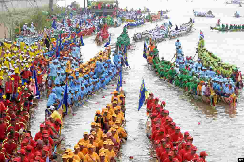 Participants row their dragon boats during the Water Festival on the Tonle Sap River in Phnom Penh, Cambodia.