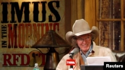 Radio personality Don Imus talks on air during his return to radio in New York, Dec. 3, 2007. Imus returned to the airwaves, after nearly an eight month absence, promising to keep his edgy tone but refrain from the kind of racist and sexist comments that got him fired.