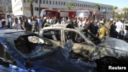 A view shows the wreckage after a car bomb exploded in the Syrian capital Damascus September 7, 2012