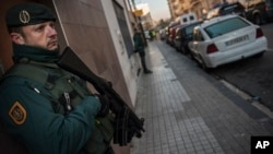 FILE - Spanish Civil Guard stand near a tea shop center (r) where they detained an unidentified man of Morocco, northern Spain, Dec.1, 2015. Statements from the interior ministries of both countries said three people were arrested in Spain's North African enclave of Ceuta while a Moroccan was arrested in the nearby Moroccan city of Ferkhana.
