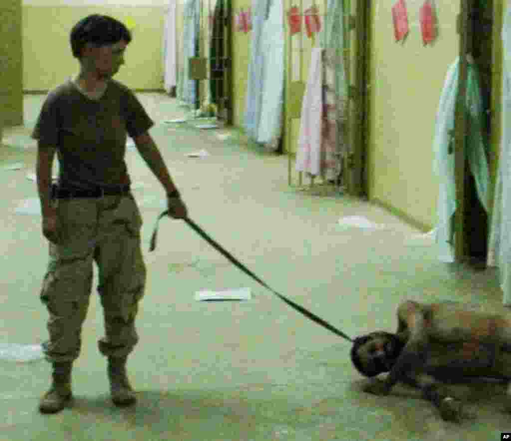 This is image obtained by The Associated Press shows Pfc. Lynndie England holding a leash attached to a detainee in late 2003 at the Abu Ghraib prison in Baghdad, Iraq.