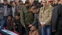 Angry Mourners Bury Damascus Bomb Victims