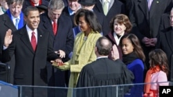 Barack Obama is sworn in by Chief Justice John Roberts as the 44th president of the United States
