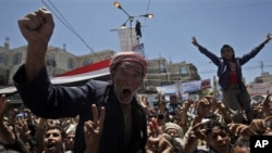 An anti-government protester reacts during a demonstration demanding the resignation of Yemeni President Ali Abdullah Saleh in Sana'a, Yemen, April 20, 2011
