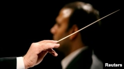 """FILE - A conductor conducts an orchestra, Jan. 3, 2007. Under the leadership — and baton — of artistic director Victor DeRenzi, the Sarasota Opera will have put on Giuseppe Verdi's """"La Battaglia di Legnano"""" (""""The Battle of Legnano""""), a fully staged production of every opera written by the prolific Italian composer, including the many revisions he made over his lifespan of 87 years."""