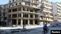 Пошкоджені будинки в Алеппо