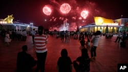 North Koreans gathered at Kim Il Sung Square to watch as fireworks explode in central Pyongyang, North Korea, July 27, 2014.