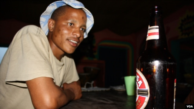 Dali Maleyile acknowledges that binge drinking is a problem in his home village (D. Taylor/VOA)
