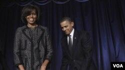 Presiden Barack Obama dan Michelle Obama saat tiba pada acara 'National Prayer Breakfast' di Washington, Kamis (3/2).