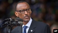 FILE - Rwandan President Paul Kagame addresses the public and dignitaries at a ceremony to mark the 20th anniversary of the Rwandan genocide, at Amahoro stadium in Kigali, Rwanda.