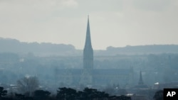 The combined tower and spire of Salisbury Cathedral stand surrounded by the medieval city where former Russian double agent Sergei Skripal and his daughter were found critically ill following exposure to the Russian-developed nerve agent Novichok in Salisbury, England, Tuesday, March 13, 2018.