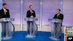 三位行政長官候選人何俊仁(右起)、唐英年、梁振英出席選舉電視論壇