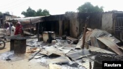 Bangunan yang hancur akibat serangan bom di Maiduguri, Nigeria Utara, pada Januari 2014.