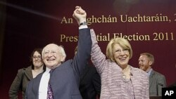 Michael Higgins, left, and his wife Sabina react after he won in the first count in the election to be next President of Ireland at Dublin Castle, Ireland, October 28, 2011.