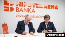 Ugovor su u prostorijama banke potpisali osnivač Instituta Dragan Hajduković i glavni izvršni direktor Hipotekarne banke Esad Zaimović (rtcg.me)