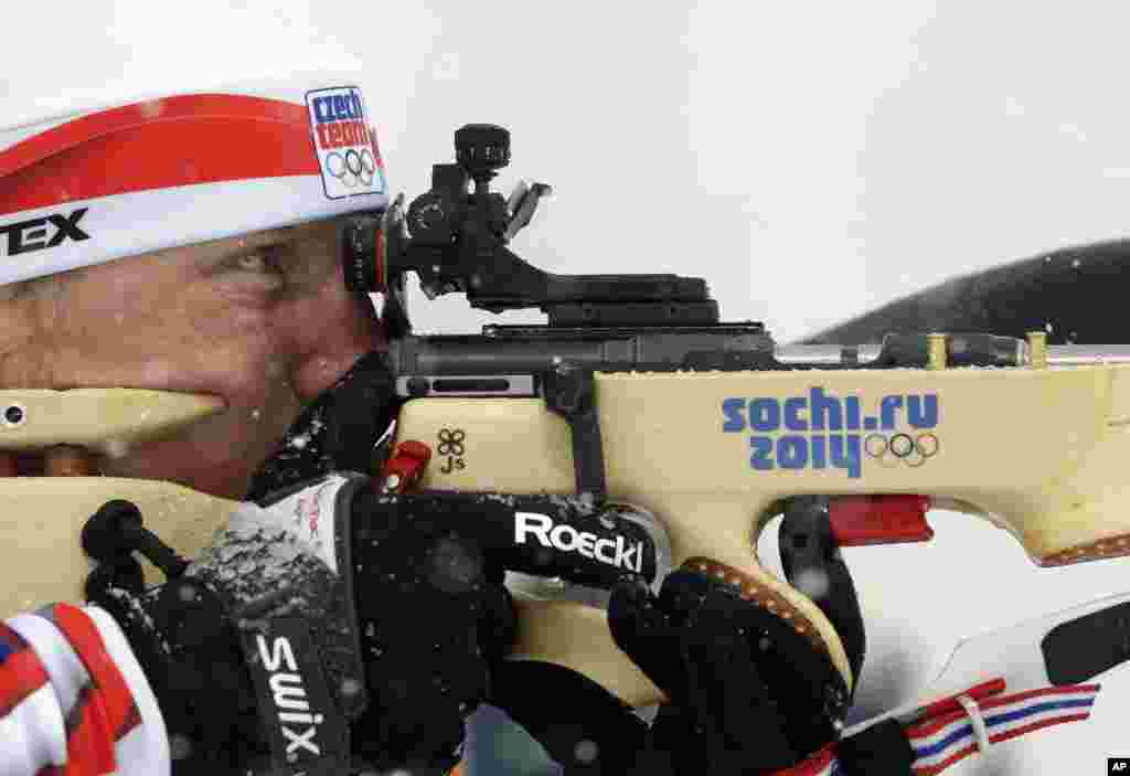 Czech Republic's Ondrej Moravec shoots during the men's biathlon 15k mass-start, at the 2014 Winter Olympics, Feb. 18, 2014.