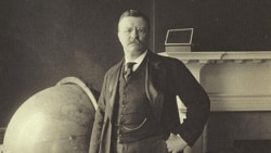 President Theodore Roosevelt stands by a globe in this 1905 photograph