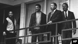 FILE - The Rev. Martin Luther King Jr. stands with other civil rights leaders on the balcony of the Lorraine Motel in Memphis, Tenn., a day before he was assassinated at approximately the same place, April 3, 1968.