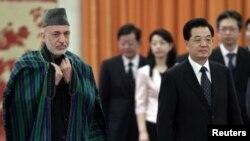Avganistanski predsednik Hamid Karzai i kineski predsednik Hu Đintao u Pekingu, 8. jun 2012.