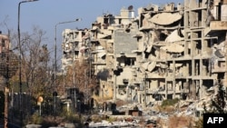 Destruction is seen in Aleppo's Bustan al-Basha neighborhood during Syrian pro-government forces assault to retake the entire northern city from rebel fighters.