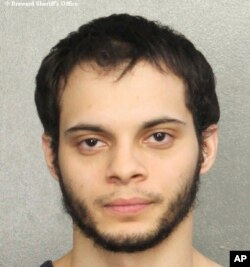 This booking photo provided by the Broward Sheriff's Office shows suspect Esteban Ruiz Santiago, 26, Jan. 7, 2017, in Fort Lauderdale, Fla.