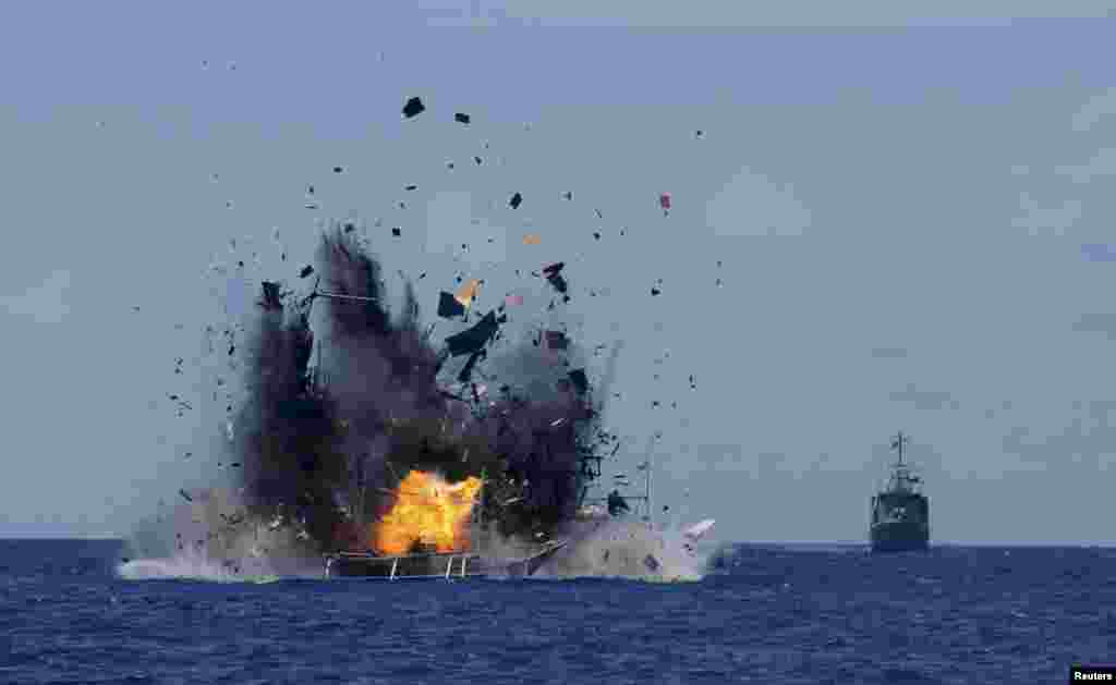 The Indonesian navy destroys foreign fishing vessels caught fishing illegally in Indonesian waters near Bitung, North Sulawesi. A total of 19 foreign boats from Vietnam, Thailand, Philippines and one from China, were destroyed near Bitung as part of an ongoing crackdown by the Indonesian government on illegal fishing.