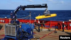 FILE - The Bluefin 21, the Artemis autonomous underwater vehicle (AUV), is hoisted back on board the Australian Defense Vessel Ocean Shield after a successful buoyancy test in the southern Indian Ocean as part of the continuing search for the missing Malaysian Airlines flight MH370 in this picture released by the U.S. Navy, April 4, 2014.