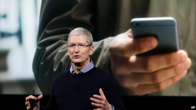 Apple CEO Tim Cook speaks at an event to announce new products at Apple headquarters, March 21, 2016, in Cupertino, California.