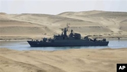 The Iranian navy frigate IS Alvand passes through the Suez canal at Ismailia, Egypt, Tuesday, Feb.22, 2011