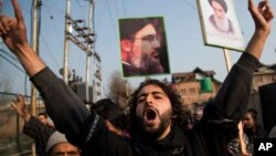 FILE - A Kashmiri Shiite Muslim shouts slogans against the Nigerian government and the detaining of their leader Ibraheem Zakzaky in Nigeria, in Srinagar, Indian-controlled Kashmir, Dec. 18, 2015. Nigeria has since ruled the group illegal.