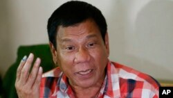 Front-running presidential candidate Mayor Rodrigo Duterte gestures during his second news conference after voting in a polling precinct at Daniel R. Aguinaldo National High School, Matina district, his hometown in Davao city in southern Philippines, May
