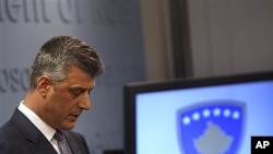 Kosovo Prime Minister Hashim Thaci makes his first public appearance since he was allegedly accused in Council of Europe investigator Dick Marty's report for organ trafficking in Pristina on Thursday, Dec. 16, 2010. Marty rocked Kosovo with his allegation