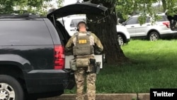 An FBI officer is seen on the site of a shooting in northeastern Maryland. (Credit - @ScottWykoffWBAL)