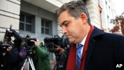 CNN's Jim Acosta walks into federal court in Washington, Nov. 14, 2018, to attend a hearing on a legal challenge against President Donald Trump's administration.
