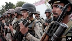 Afghan soldiers stand to attention during the third phase of a transfer of an authority from NATO-led troops. (file)