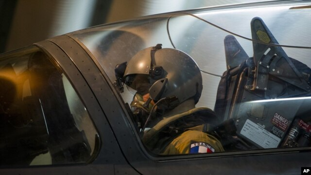 French Army photo shows a French fighter pilot preparing to take off at Kossei camp in Chad, Jan. 11, 2013.