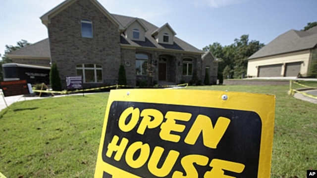 An open house sign is displayed in front of a new home being readied for sale in Little Rock, Arkansas, August 22, 2011.